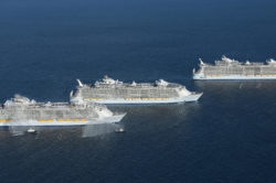 HM, aerials, Three Sisters event, Harmony of the Seas sails on maiden voyage out of Port Everglades, Fort Lauderdale, Nov 5, 2016, joined by her two sister ships, Oasis of the Seas and Allure of the Seas, starboard side view, ocean, horizon, flotilla send-off, (three ships aligned, Harmony in front)